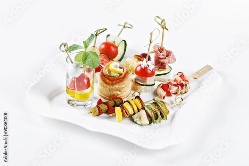 Carta da parati close-up view set of canapes with vegetables, salami, seafood, meat and decorati