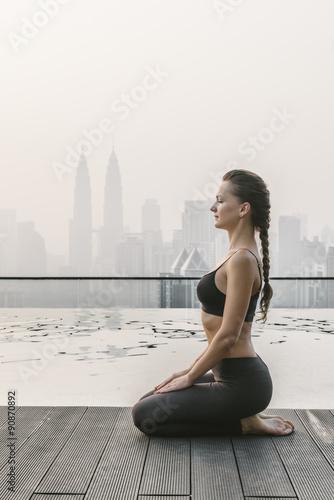 Woman Doing Yoga in a Big City Wallpaper Mural