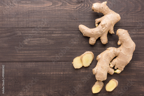 Fotografie, Obraz  Ginger root on the wooden background. Top view