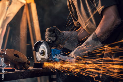 Close-up of worker cutting metal with grinder Fotobehang