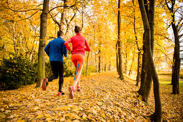 Naklejka Couple jogging in autumn nature