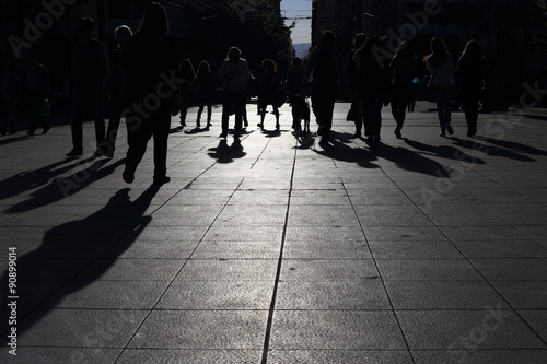 fototapeta na szkło Shadows of people walking in a street of the city, Athens