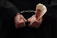 Hands In Handcuffs And Money