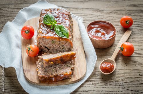 Meat loaf with barbecue sauce on the wooden board Wallpaper Mural