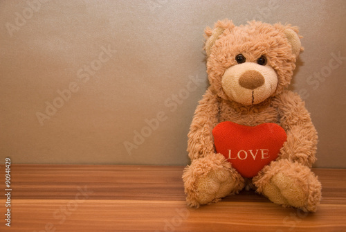 obraz PCV Teddy bear with a red heart