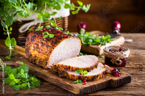 Fototapeta Roasted pork loin with cranberry and marjoram obraz