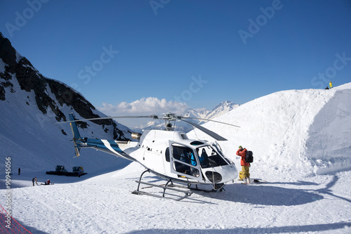obraz dibond White rescue helicopter parked in the mountains