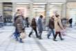 Commuters in motion blur