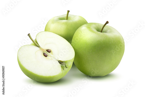 Leinwand Poster Green apples and half isolated on white background