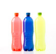 Bottles of soft drinks on white background