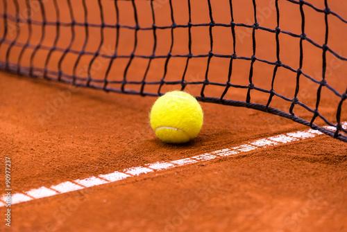 tennis ball on a clay court