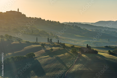 Foto op Aluminium Blauw Hazy and mystical landscape of Tuscany at sunrise