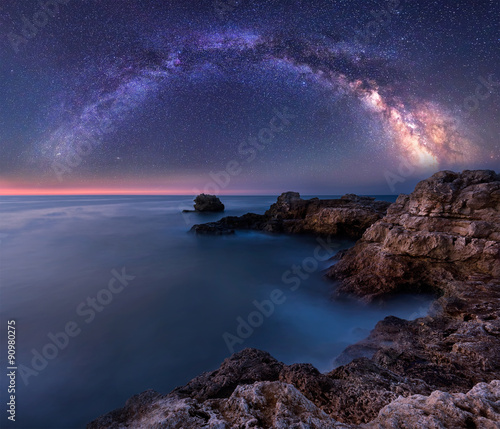Photo Stands Night blue Milky Way over the sea. Night landscape with Milky Way Galaxy above the Black sea