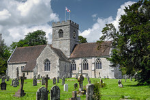 Quintessential English Village Church And Cemetery On A Summers Afternoon.
