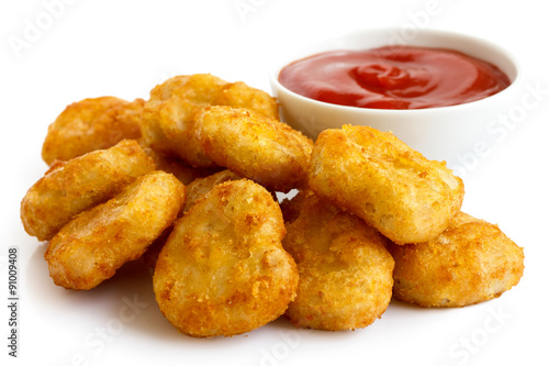 Keuken foto achterwand Kip Pile of golden deep-fried battered chicken nuggets with bowl of