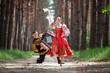 Leinwandbild Motiv Man and woman in Russian national clothes