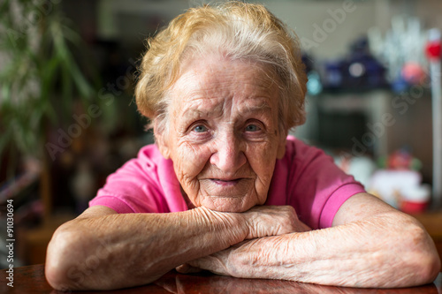 Fotografia  Closeup portrait of happy elderly woman.