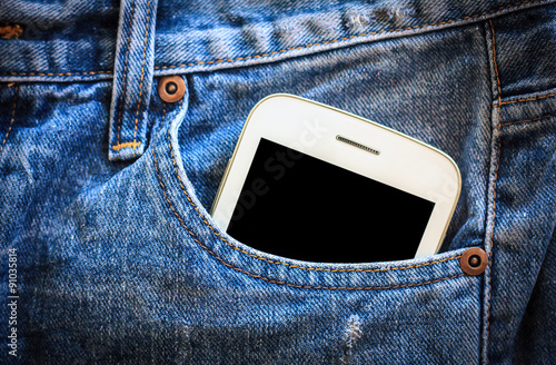 Fotografía  mobile phone in jeans pocket with black screen