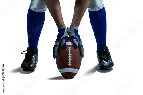 Fotografiet  Low section of American football player placing ball