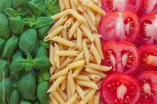 Tela  italian food with background - pasta, tomato, basil