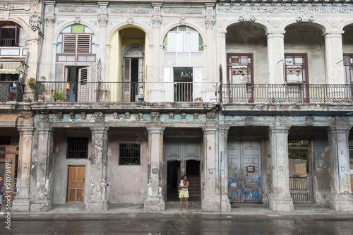 Rainy day view of classic colonial architecture on the facade of a crumbling bui Canvas Print