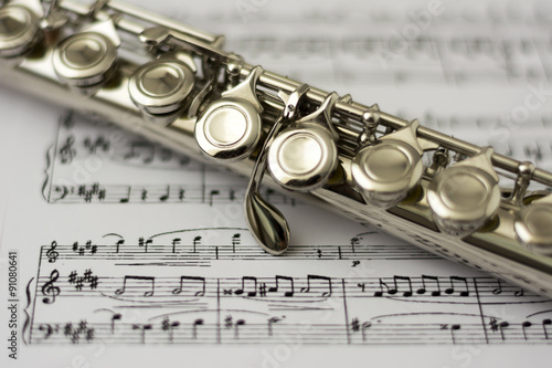 Slika na platnu Close up flute on flute sheet music background