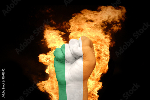 Photo  fire fist with the national flag of ireland