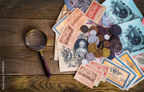 Fotografering  Old Russian money and medals.