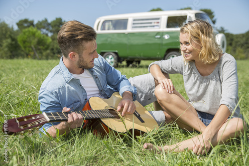 Fotografia, Obraz  romantic couple of lover playing guitar