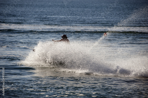 Foto op Plexiglas Water Motor sporten A man cruises the sea on a jet ski.