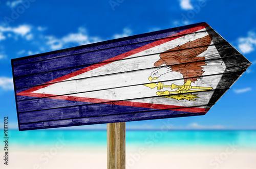 Foto op Canvas Australië American Samoa Flag wooden sign on beach background
