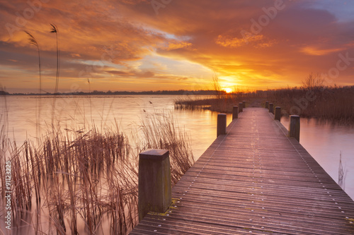 Boardwalk over water at sunrise, near Amsterdam The Netherlands