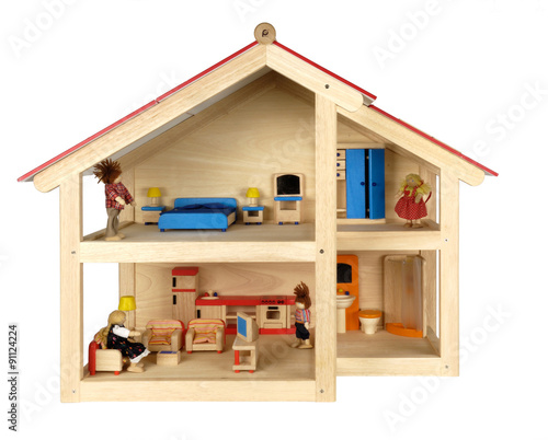 Photo  Child's doll house with furniture