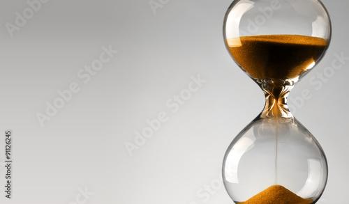 Obraz Time passing. Orange hourglass. - fototapety do salonu