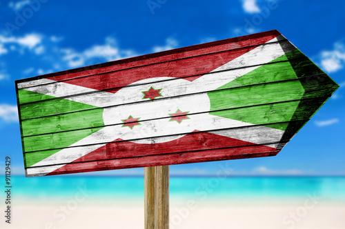 Foto op Canvas Australië Burundi Flag wooden sign on beach background
