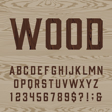 Wooden Retro Alphabet Vector Font. Type Letters, Numbers And Symbols On The Light Wood Background. Vintage Vector Typography For Labels, Headlines, Posters Etc.