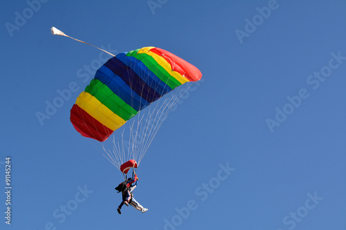Foto op Canvas Luchtsport People jumping with the parachute