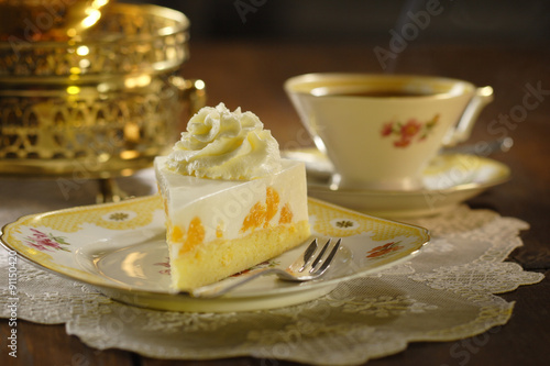 Photo cake with cream and tangerines