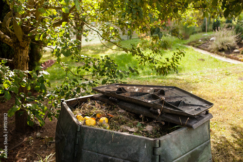 Small outdoor composting bin for recycling kitchen and garden organic waste #91151812