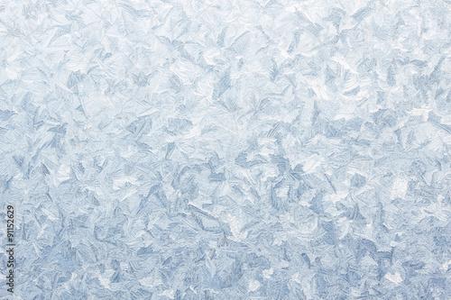 Photo  ice pattern on frozen window christmas background