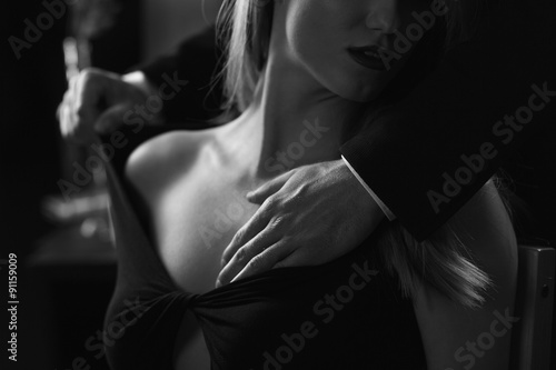 Photo  Male hands touching female bust