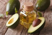 Vitamin Avocado Oil In A Glass Bottle On A Table Close-up, Horizontal