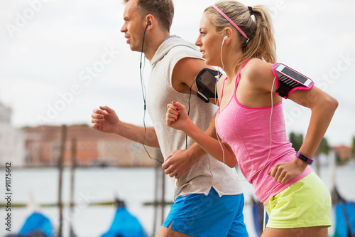 plakat Woman and man running outdoors together