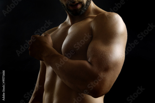 portrait of a man with biceps Fototapeta