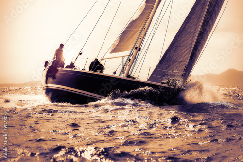 Tuinposter Zeilen sail boat sailing on sunset