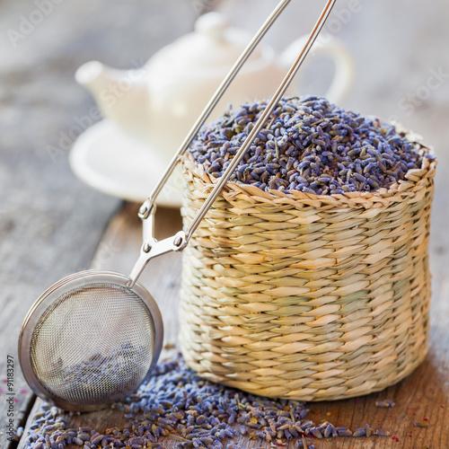 Fotografia, Obraz  Lavender herbal tea in basket, tea infuser and teapot on backgro