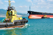 Tanker Barge And Powerful Tugboats In Sea