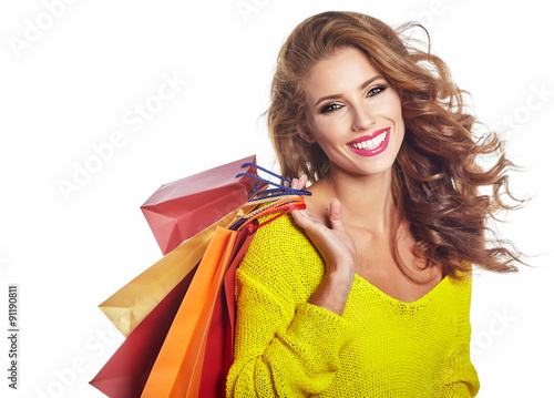 Fotografía  Shopping woman holding bags, isolated on white studio background