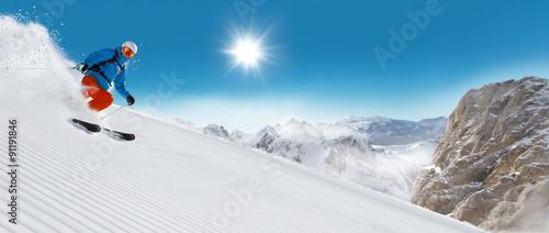 Fotobehang Wintersporten Man skier running downhill