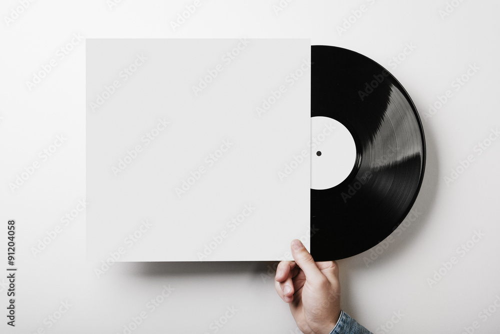 Photo & Art Print Hand holding vinyl music album template on white ...